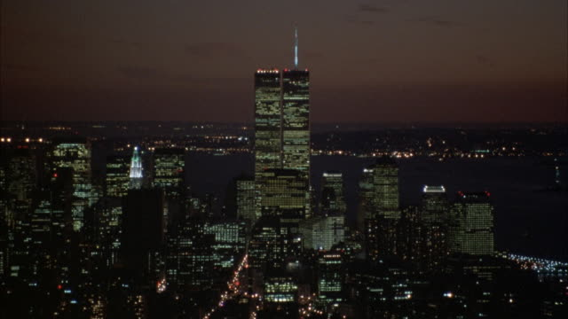 wide angle of new york city skyline with world trade center surrounded by other skyscrapers. - world trade center manhattan stock videos & royalty-free footage