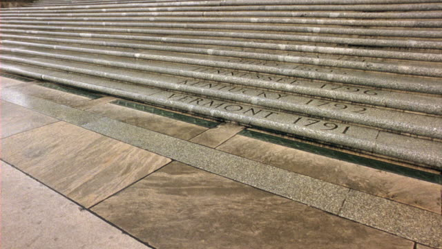 medium angle of steps of the capitol building in baton rouge, louisiana.  state names and years are etched in the stone steps. government buildings. - kapitol von louisiana stock-videos und b-roll-filmmaterial
