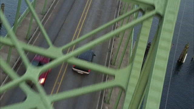 tracking shot of navy and tan ford explorer driving over yaquina bay bridge. marinas and newport, oregon coast visible. - newport oregon stock videos & royalty-free footage