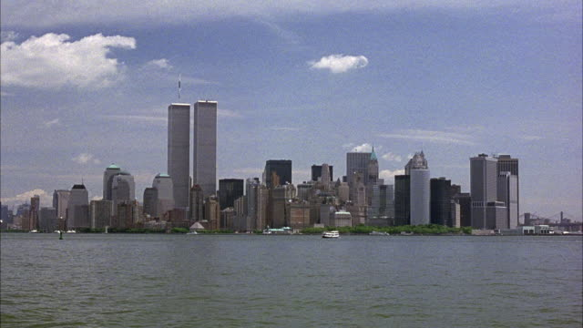 WIDE ANGLE OF NEW YORK CITY SKYLINE.  INCLUDES WORLD TRADE CENTER TWIN TOWERS.  PRE- 9-11. POV FROM WATER.