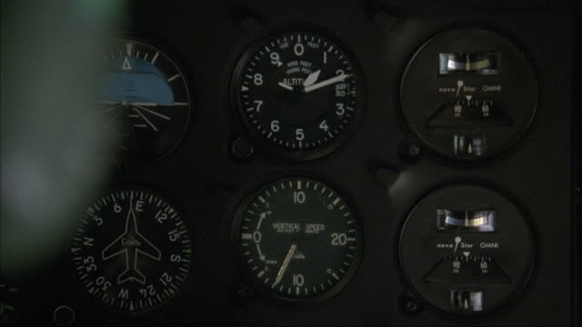 close angle of instrument panel in airplane. altimeter losing altitude, pans right to see hand adjust knob, then pans up to gps system. pans left to altimeter, then back right to gps. neg cut. inserts. - cockpit stock videos & royalty-free footage