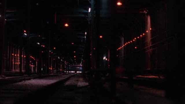 wide angle in underground subway tunnel. subway train off tracks rolls over toward camera and crashes support columns. train comes to rest.  smoke and dust. accidents. disasters. - 1995 stock-videos und b-roll-filmmaterial