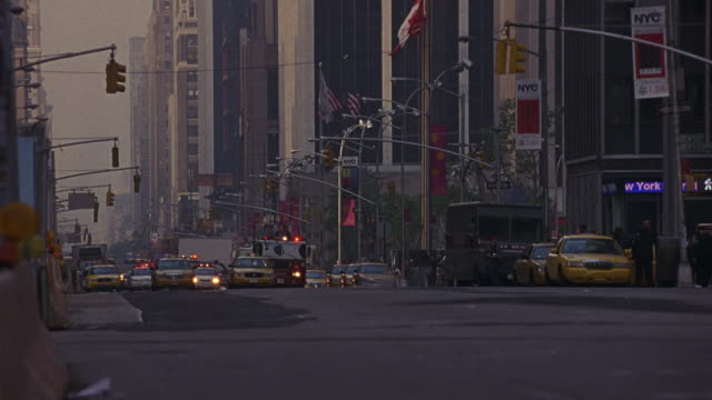 wide angle of city street, fire engines and police cars speeding through traffic with sirens, flashing lights, bizbars. nypd. nyfd. emergency vehicles. - 1989 stock videos and b-roll footage