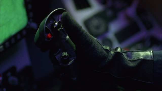 close angle of jet joystick.  hand wearing glove moves stick back and forth and presses several buttons.  insert. - computer game control stock videos and b-roll footage