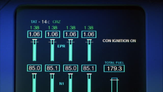 close angle of computer screen on control panel for jet, probably fuel gauge that monitors fuel levels. - gauge stock videos & royalty-free footage