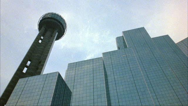 UP ANGLE OF LIT UP GLOBE TOWER OF HYATT REGENCY REUNION HOTEL.  DARK SHOT. FUTURISTIC. DALLAS CITY LANDMARK.