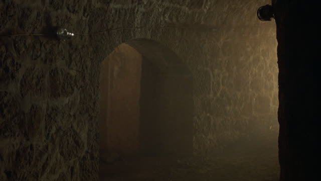 wide angle of stone walls of hallways or tunnels or chambers in castle or basement. - basement stock videos and b-roll footage