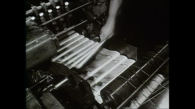 "newspapers through printing press / copy of paper picked from production line / front page ""the sun"" headline re missing prime minister harold holt... - pressa da stampa video stock e b–roll"