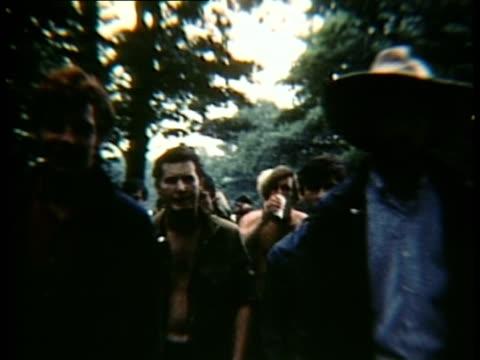 Walking among crowd at Woodstock music Festival/ Bethel New York USA