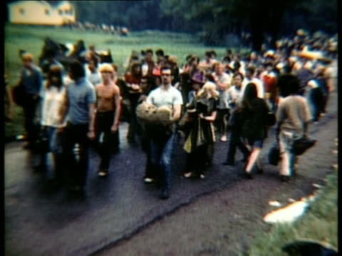 crowd walking along dirt path at woodstock music festival/ bethel, new york, usa - wide shot stock videos & royalty-free footage