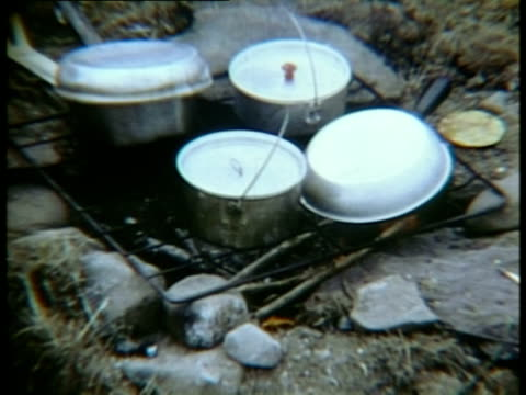 saucepans cooking over campfire at woodstock music festival/ bethel new york usa - four objects stock videos & royalty-free footage