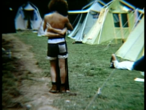 vidéos et rushes de couple embracing standing together in campsite at woodstock music festival/ bethel new york usa - hippie