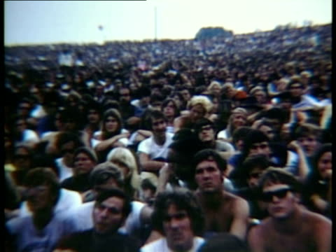 section of large crowd sitting on hill at woodstock music festival/ bethel new york usa - 1969年点の映像素材/bロール
