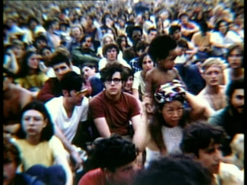 section of large crowd sitting at woodstock music festival/ bethel new york usa - 1969年点の映像素材/bロール