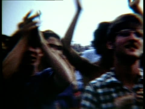 sections of the crowd clapping to music and cheering at woodstock music festival/ bethel, new york, usa - fence点の映像素材/bロール