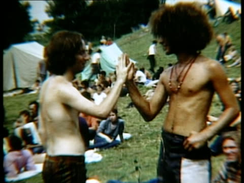 two men standing in field pressing their hands together at woodstock music festival/ bethel new york usa - 1969 stock videos & royalty-free footage