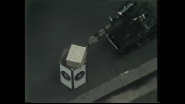 HILTON HOTEL SYDNEY BOMBING SCENE / AERIAL BLOCKED OFF GEORGE STREET / POLICE RESCUE OFFICER / GARBAGE BINS OVERTURNED POLICE BOMB EXPERTS USING ROPE...