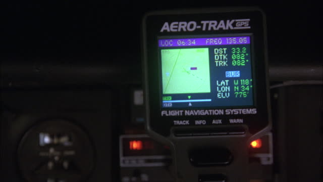 CLOSE ANGLE OF AIRPLANE INSTRUMENT PANELS AND AERO-TRACK GPS SYSTEM. ALTIMETER APPEARS TO BE LOSING ALTITUDE, THEN STOPS FALLING AND BEGINS TO SLOWLY CLIMB AGAIN. PANS LEFT AND RIGHT TO INSTRUMENTS AND GPS DEVICE SEVERAL TIMES.