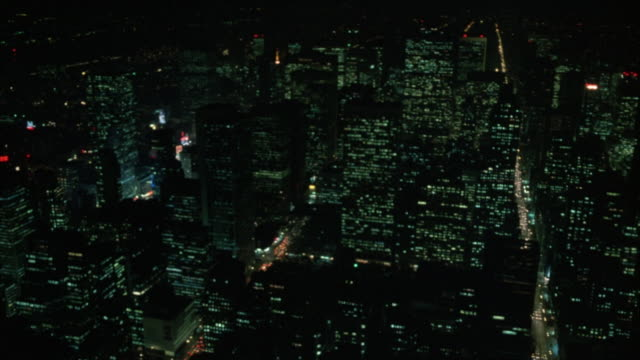 pov shot of new york city skyline at night. camera pans l-r, starting with  times square area visible in distance and ending on chrysler building and pan am or metlife building. - 1984 stock videos & royalty-free footage