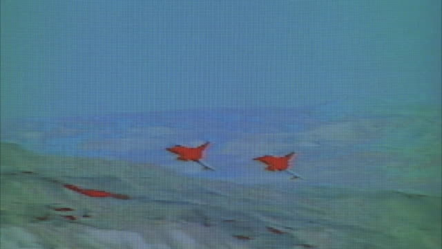 pan right to left of two f-16 fighter jets flying over desert toward camera. infrared. middle east. - fighter stock videos & royalty-free footage