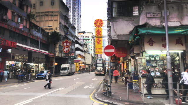 street of kowloon with traffic - mar stock videos & royalty-free footage