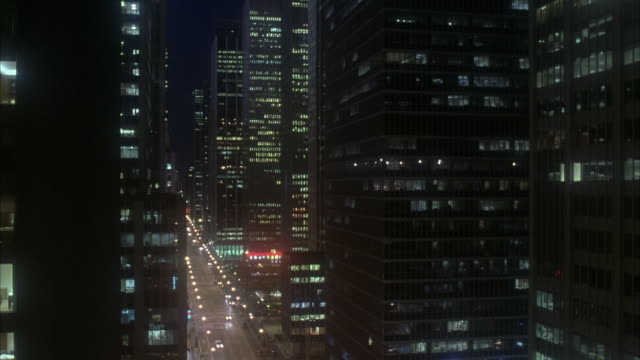 pan left to right of high rise buildings in downtown new york. see traffic on street below. avenue of the americas. office buildings. midtown manhattan. - 1998 stock videos and b-roll footage