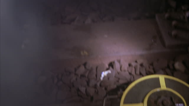 close angle of railroad or subway tracks. land mines or bombs wired along tracks. flashlight pans back and forth on land mines. could be subway tunnel. - land mine stock videos and b-roll footage