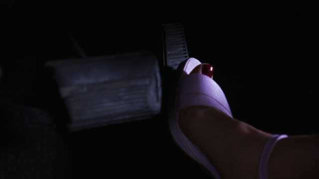 close angle of woman's foot pressing gas pedal driving car or truck. see white or pink satin sandal or shoe on foot. see toes painted red. - pedal stock videos & royalty-free footage