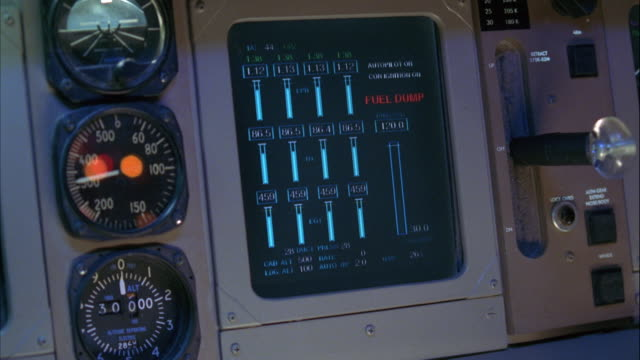 close angle of computer screen on control panel for jet, probably fuel gauge that monitors fuel levels. red blinking light that reads low fuel begins flashing. - gauge stock videos & royalty-free footage