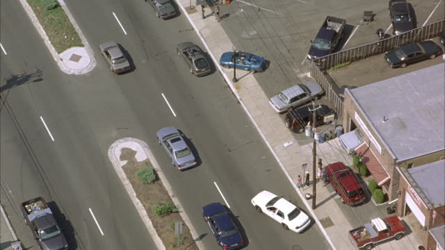 aerial birdseye pov tracking shot of silver mercedes down street as it weaves through traffic. then see car stop at red light. - mercedes benz stock videos and b-roll footage