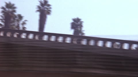 process plate passenger side of car driving on highway, probably i-710 (long beach freeway). pass signs that read port of long beach queen mary, and one that reads magnolia ave. at end. - long beach california video stock e b–roll