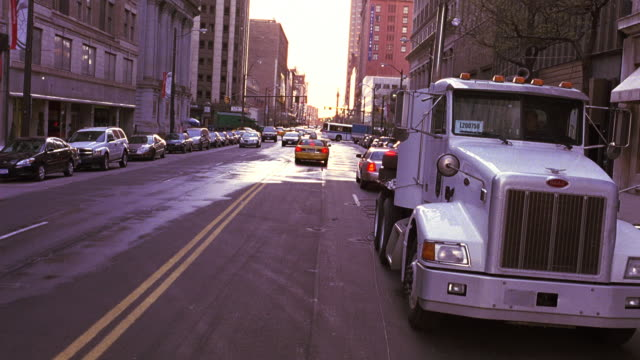 medium angle, driving pov straight forward of nyc street. pov passing taxi, cars.  garbage truck, parked vehicles ahead, camera simulates crash collision into garbage truck. accidents. - garbage truck stock videos and b-roll footage
