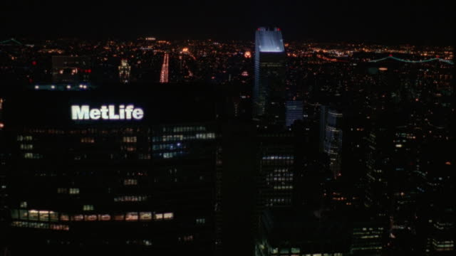 aerial of new york city, starts at metlife building and moves to chrysler building. see headlights from traffic in streets below. - 1994 stock videos and b-roll footage