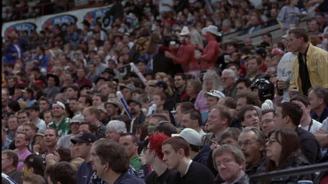 wide angle of crowd in stadium seats. could be football, baseball, basketball, or hockey game at sports arena. - wide angle stock videos & royalty-free footage