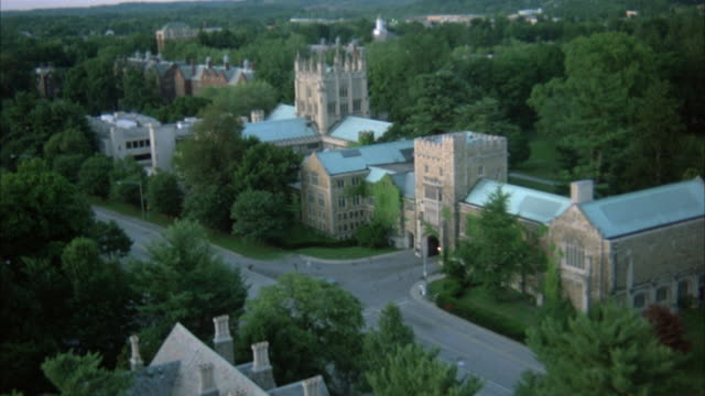 aerial over vassar college. could be used for  ivy league school, university college campuses. low level flight over trees, gothic style library building, dormitories, lecture halls, brick buildings, campus quad. - ivy league university stock videos and b-roll footage