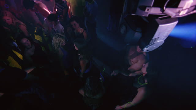 high angle down of a crowd of college age men and women dancing, probably students.  could be a party, rave, dance club, concert, disco, or discotheque. - infestation stock videos & royalty-free footage