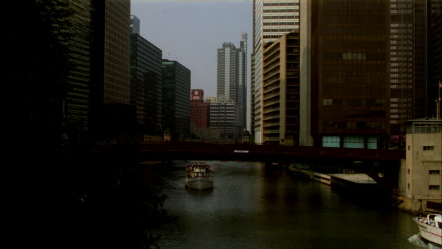 pan down from view of sears tower and 311 s. wacker building to a ferry and boats on chicago river. rapid pan up to sears tower and wacker building. pan down to ferry on chicago river. - river green stock videos & royalty-free footage