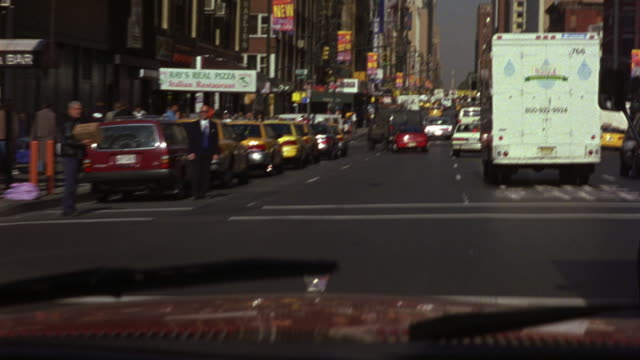 medium angle driving pov through medium traffic on four lane new york city street. camera follows white 1987 buick lesabre as both cars swerve through traffic. looks like car chase. neg cut. - anno 1999 video stock e b–roll