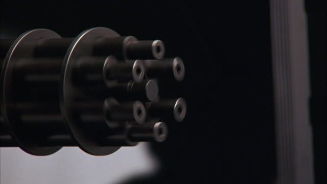 close angle of barrel of rotating machine gun. see barrel rotate right on weapon mount. see machine gun continue to fire. - machine gun stock videos and b-roll footage