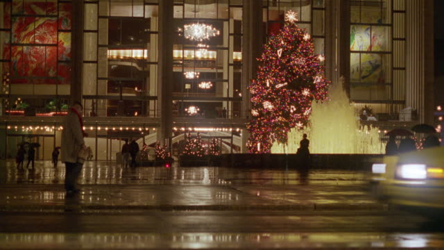 process plate of lit christmas tree and fountain in front of avery fisher hall, lincoln center, upper west side. pov is from car parallel parking across street. - parallel parking stock videos & royalty-free footage
