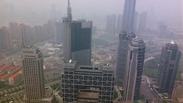 aerial view of downtown shanghai skyline. skyscrapers in downtown of city. see helipads on top of some buildings. multi-story or high rise buildings in background. - office block exterior stock-videos und b-roll-filmmaterial