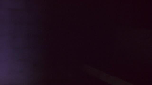 steadicam shot of corpses and prisoners in dark room. shot from person's pov looking down at floor. rats, dead bodies, skeletons, skulls, bones, corpses, lie on floor. - prisoner stock videos & royalty-free footage