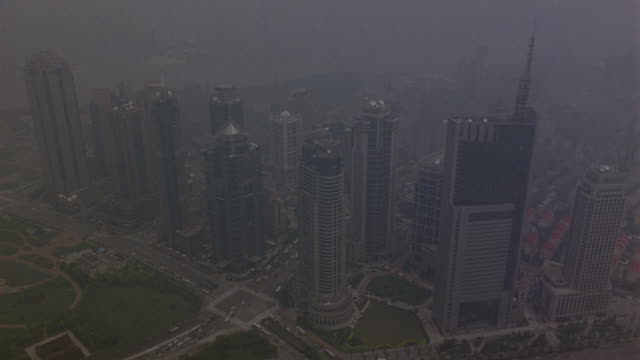 aerial of downtown pudong area of shanghai skyline. see jin mao tower. skyscrapers or multi-story high rises. could be office buildings or hotels. see group of multi-story tower block apartment buildings. - office block exterior stock-videos und b-roll-filmmaterial