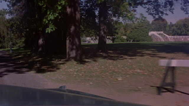 medium angle of one-way isolated paved road leading to lyndhurst mansion in tarrytown, new york. pov front windshield of 1972 cadillac deville. - gothic stock videos & royalty-free footage