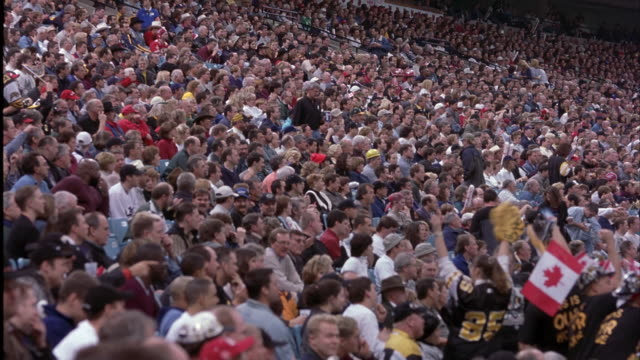 wide angle of crowd in stadium seats. see people cheering, clapping, and walking in aisles. could be reaction to play or scoring. - wide angle stock videos & royalty-free footage