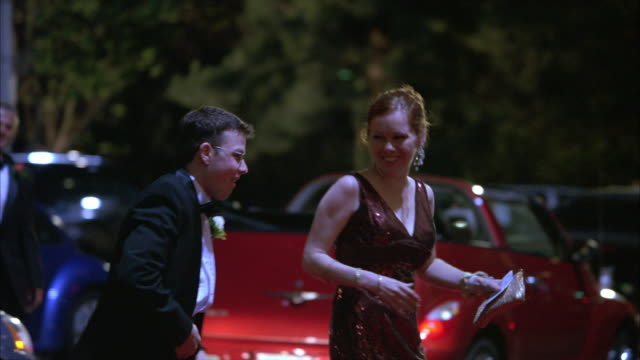 hand held of pontiac g6 convertible car with oregon license plate and limo arriving at red carpet event. valet welcomes teenagers or young men and women wearing evening gowns and tuxedos who walk past adults, snapping photographs from crowd. - pontiac stock videos and b-roll footage