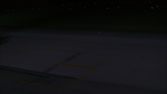 wide angle low level pilot pov entering air force base or airport. see runway and row of helicopters and airplanes. pov rises elevation, lamp pole light ray reflects on lens. - 1989 stock videos and b-roll footage