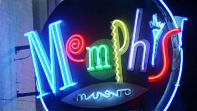 "neon signs on beale street in memphis, tennessee. out of focus ""memphis music"" neon sign. camera focuses. pans right away from sign, left back to sign. could be sign for nightclub, club, record store. - tennessee stock videos & royalty-free footage"