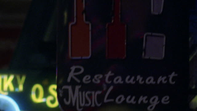 """beale street in memphis. camera pans down flashing neon sign reading """"this is it!"""" pan left to more neon signs, including """"hard rock cafe"""" on guitar. restaurants. - hard rock cafe stock videos & royalty-free footage"""