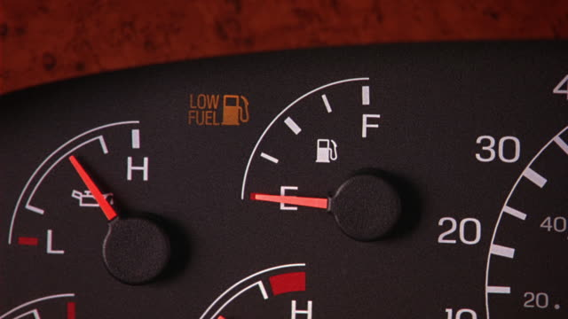 """close angle of instrument panel in car, truck, van, rv, or bus. fuel level is on """"e"""" and """"low fuel"""" light is on. dashboards. - dashboard vehicle part stock videos and b-roll footage"""